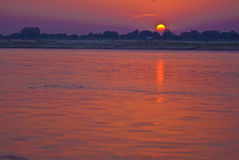 Sunrise over Ganges. A beautiful sunrise over the holy Ganges river in India royalty free stock photo