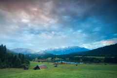 Sunrise over Geroldsee lake and alpine meadows Stock Photos