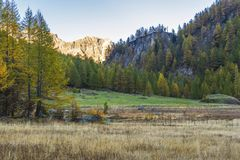 Alpe devero autumnal mountain landscape. Sunrise over the grass meadows inside the Alpe Devero flat land royalty free stock photography