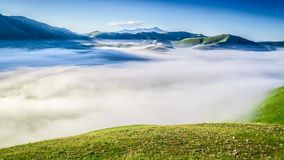 Sunrise over green field in mountain at spring, Castelluccio, Italy stock video
