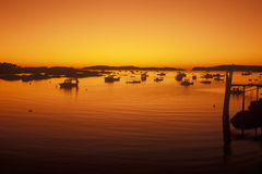 Sunrise over harbor in Stonington, ME Royalty Free Stock Images
