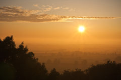 Sunrise over a hazy summer landscape Royalty Free Stock Images