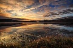 Sunrise over Hjerkinnsdammen lake, Dovre mountains. Dovrefjell-Sunndalsfjella national park, Norway royalty free stock image