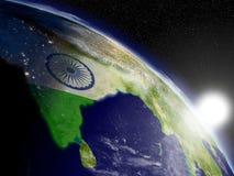 Sunrise over India with flag Royalty Free Stock Photo