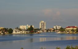 Sunrise Over The Inlet. Inlet Across Boca Ciega Bay Photographed from Boca Ciega Millinum Park, Seminole FL Stock Images