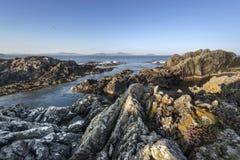 Sunrise over Irish rocky coastline Stock Images