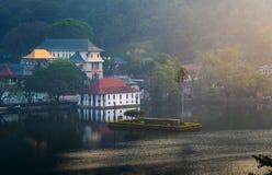Sunrise over Kandy lake and temple in Sri Lanka. Sunrise over Kandy lake and landmark temple in Sri Lanka stock photo