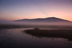 Sunrise over lake. Summer sunrise over Cerknica lake in Slovenia stock image