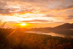 Sunrise over lake Batur Stock Photography