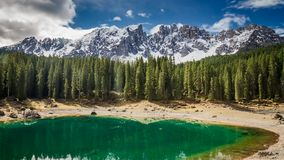 Sunrise over Lake Carezza in the Dolomites stock video footage