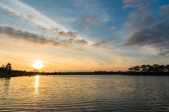 Sunrise over the lake on cloudy day Stock Photography