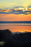 Sunrise over the lake early in the morning with beautiful clouds Royalty Free Stock Photo
