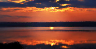 Sunrise over the lake early in the morning with beautiful clouds Royalty Free Stock Image