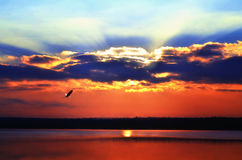 Sunrise over the lake early in the morning with beautiful clouds Stock Photo