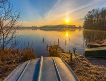 Sunrise over lake at end of winter Stock Images