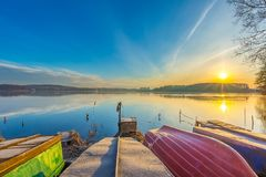 Sunrise over lake at end of winter Stock Image