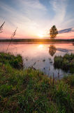 Sunrise over lake with fog above Royalty Free Stock Photography