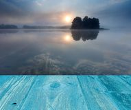 Sunrise over lake. landscape with wooden planks floor Royalty Free Stock Photography