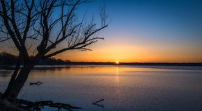 Sunrise over lake in Madison, Wisconsin. Colorful sunrise over Lake Mendota in Madison, WI in winter Royalty Free Stock Photo