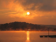 Sunrise over Lake Monroe. July morning at lake monroe Indiana. Fog was just starting to lift off and I caught this from the boat ramp Stock Photos