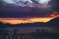 The sunrise over a lake and mountains. The place is close to volcano Batur, Bali island. royalty free stock photos
