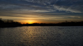 Sunrise over a lake near the Des Moines river. Golden sunrise over a lake near the Des Moines river Royalty Free Stock Image