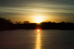 Sunrise over a lake near the Des Moines river. Golden sunrise over a lake near the Des Moines river Stock Images