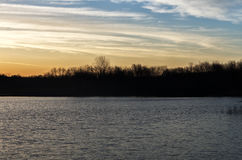 Sunrise over a lake near the Des Moines river. Golden sunrise over a lake near the Des Moines river Stock Photo