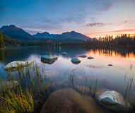 The sunrise over a lake in the park High Tatras. Shtrbske Pleso, Stock Image