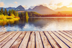 The sunrise over a lake in the park High Tatras. Royalty Free Stock Photo