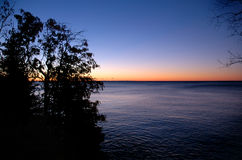 Sunrise over Lake Superior. With trees stock image