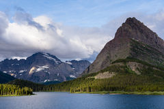 Sunrise over Lake Swiftcurrent in Glacier National Park Stock Photo