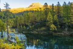 Alpe devero autumnal mountain landscape. Sunrise over the Lake of the witches inside the Alpe Devero flat land royalty free stock photo