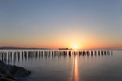 Sunrise over Limassol pier. A long exposure of a sunrise creating feelings of calmness serenity and peasefulness Royalty Free Stock Images