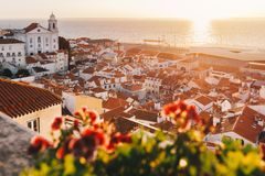 Sunrise Over Lisbon Old Town Alfama - Portugal. Lisbon Golden Hour Skyline. Balcony View on Alfama Old Town of Lisbon and Tagus. Sunrise Over Lisbon Old Town royalty free stock photos
