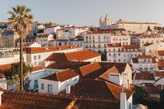 Sunrise Over Lisbon Old Town Alfama - Portugal. Lisbon Golden Hour Skyline. Balcony View on Alfama Old Town of Lisbon and Tagus. Sunrise Over Lisbon Old Town royalty free stock image
