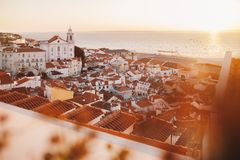 Sunrise Over Lisbon Old Town Alfama - Portugal. Lisbon Golden Hour Skyline. Balcony View on Alfama Old Town of Lisbon and Tagus. Sunrise Over Lisbon Old Town royalty free stock photo