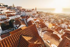 Sunrise Over Lisbon Old Town Alfama - Portugal. Lisbon Golden Hour Skyline. Balcony View on Alfama Old Town of Lisbon and Tagus. Sunrise Over Lisbon Old Town stock image