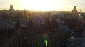 Sunrise over Liverpool city roof tops with Limestreet station stock footage