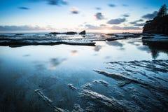 Sunrise over looking ocean Stock Photo