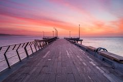 Sunrise over the Lorne Jetty on the Great Ocean Road in Victoria stock photo
