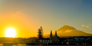 Sunrise over Madalena and Pico volcano and island, Azores, Portugal. Sunrise over Madalena and Pico volcano and island at Azores, Portugal Royalty Free Stock Images