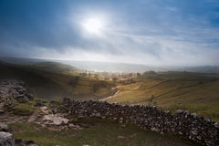 Sunrise over Malham Cove and Dale in Yorkshire Dales National Pa royalty free stock images