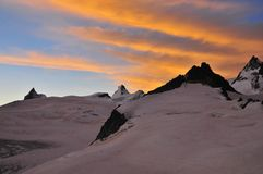 Sunrise over the matterhorn. (4476m) and the Dent d'Herens (4171m). In the fore ground the mont mines glacier Royalty Free Stock Photography