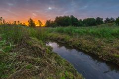 Sunrise over meadow and river Royalty Free Stock Image