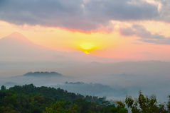 Sunrise over Merapi volcano and Borobudur temple, Indonesia Royalty Free Stock Photo
