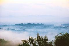 Sunrise over Merapi volcano and Borobudur temple, Indonesia Stock Photos