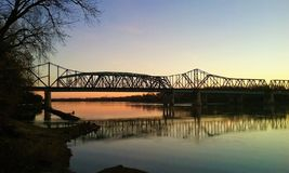 Sunrise over the Missouri River. Train bridge over the Missouri River in Saint Charles Missouri at sunrise royalty free stock images
