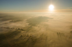 Sunrise over the misty fall landscape from the air Stock Photography