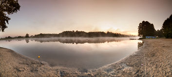 Sunrise over the misty lake panorama Royalty Free Stock Images